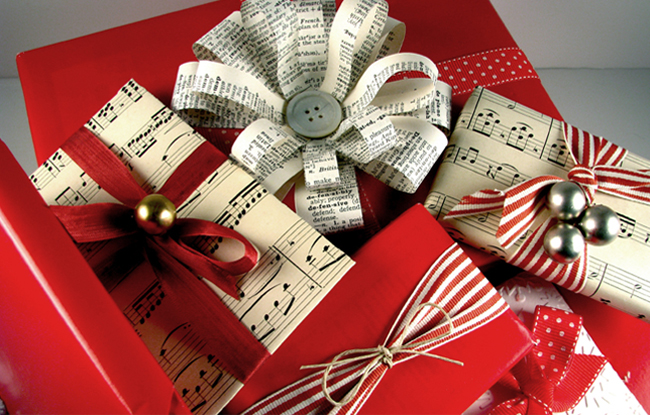 Christmas gift wrapped with music sheets