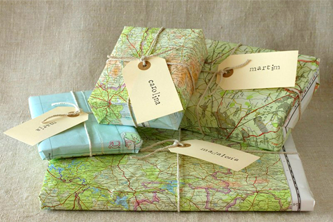 gift box wrapped with old maps